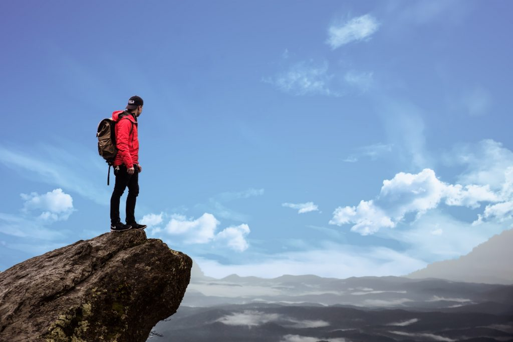 Man on a mountain top taking in the view.