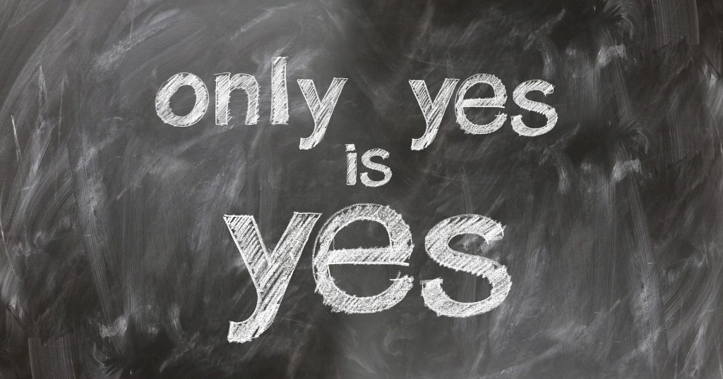 Only yes is yes written in chalk on a blackboard.
