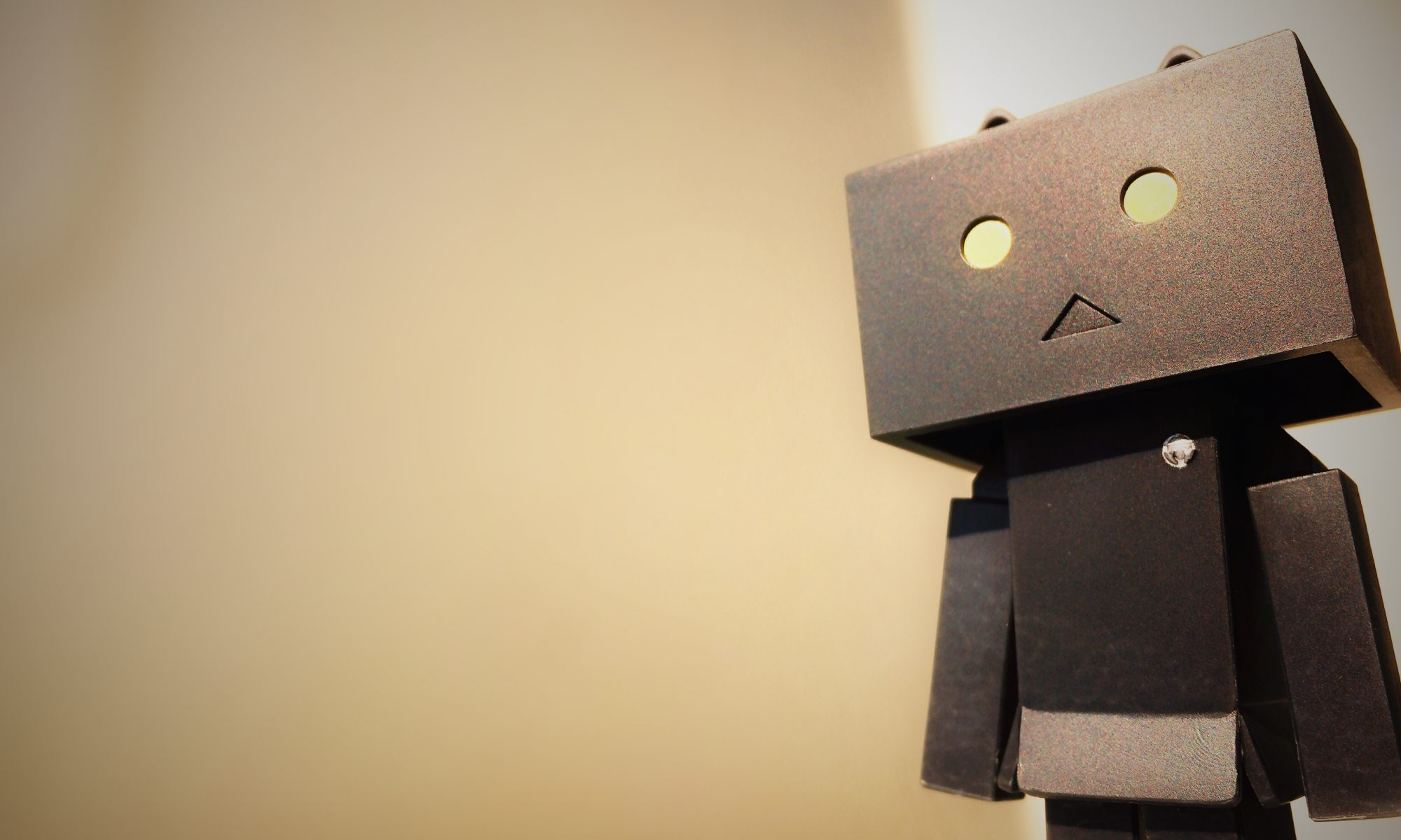 Cardboard robot thinking about how to become more creative and productive