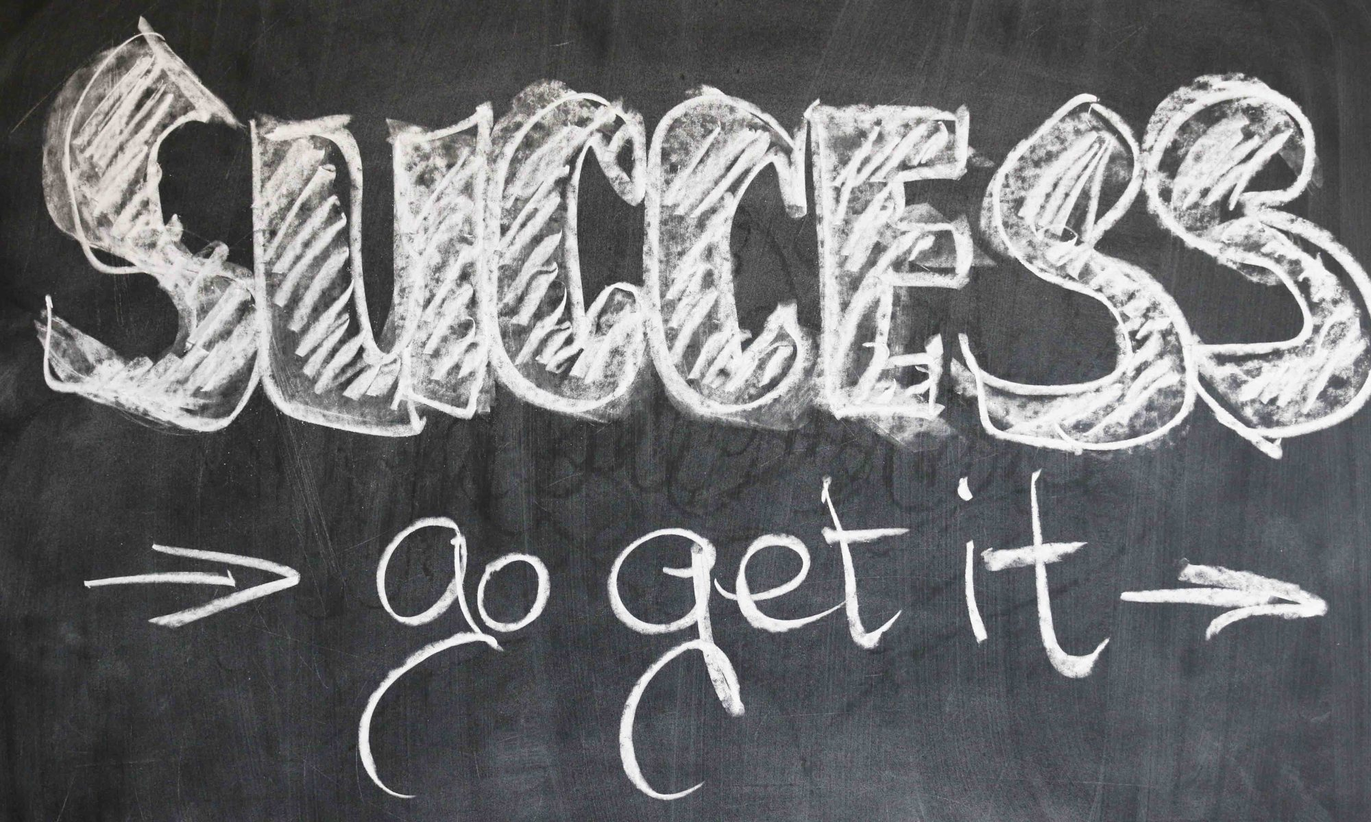 Success: go get it! Written in chalk on a blackboard