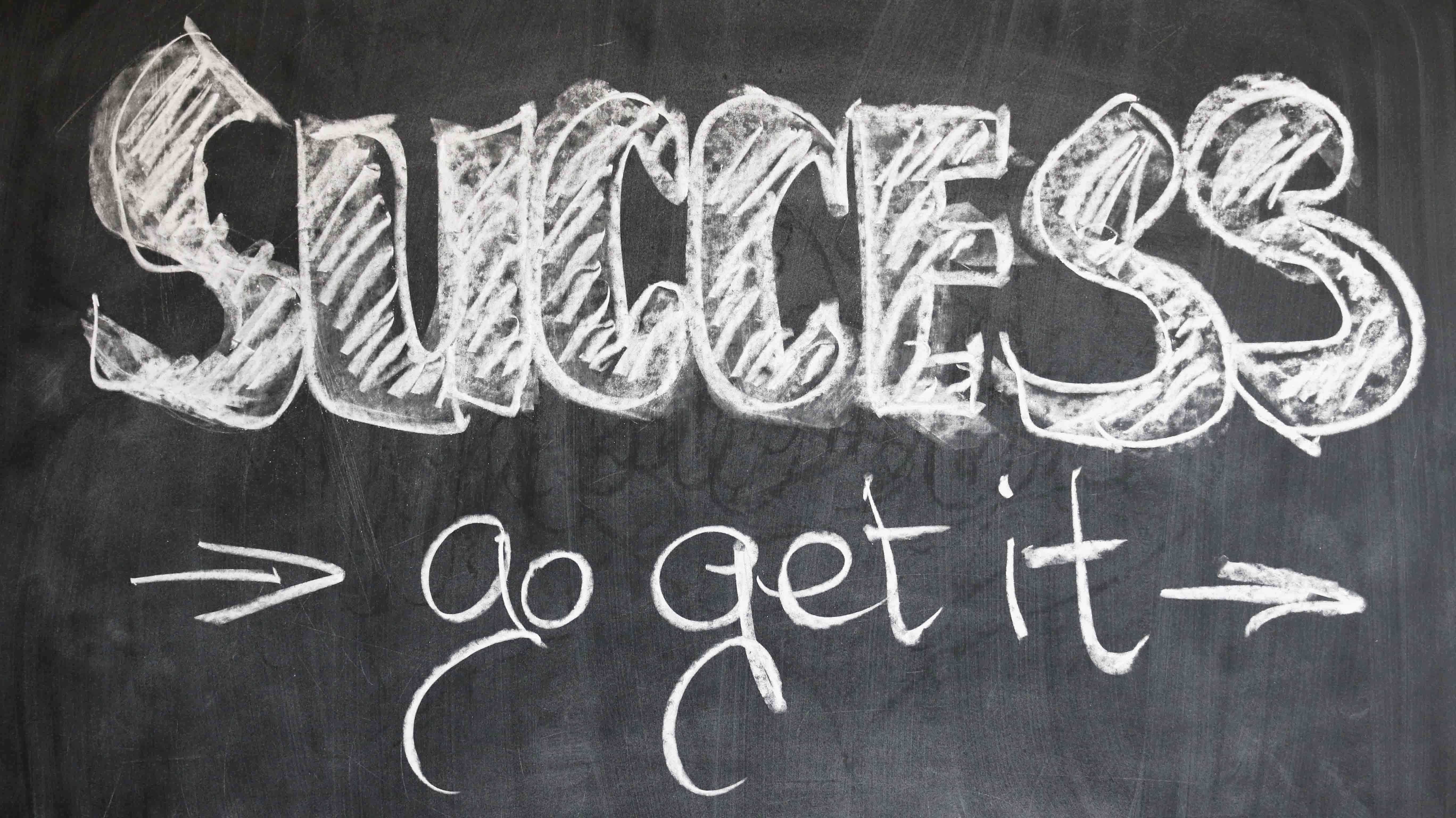Success: go get it! Written in chalk on a blackboard